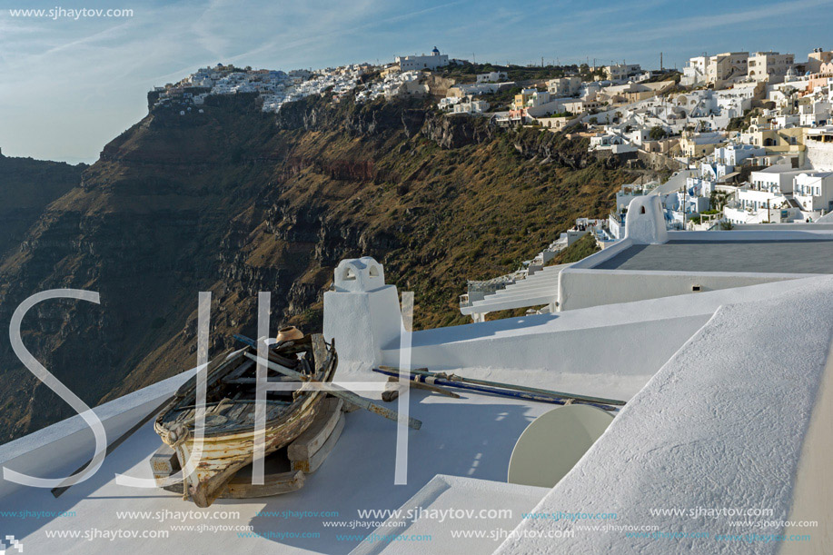 Old boat and Panoramic view to towns of Imerovigli and Firostefani, Thira, Cyclades, Greece