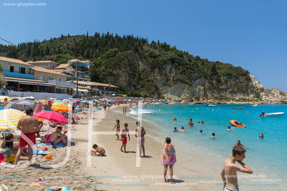 AGIOS NIKITAS, LEFKADA, GREECE - JULY 16, 2014: Tourist visiting beach of village of Agios Nikitas, Lefkada, Ionian Islands, Greece