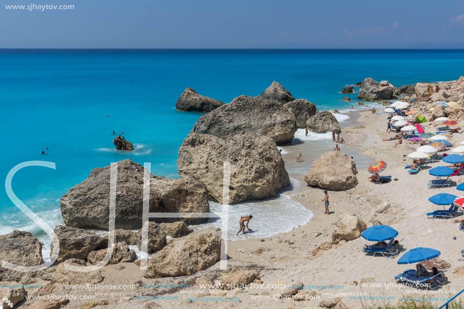 MEGALI PETRA BEACH, LEFKADA, GREECE - JULY 16, 2014: Panoramic view of blue waters of Megali Petra Beach, Lefkada, Ionian Islands, Greece